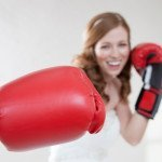 Beautiful bride in boxing gloves